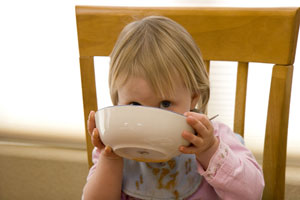 Child Drinking Soup
